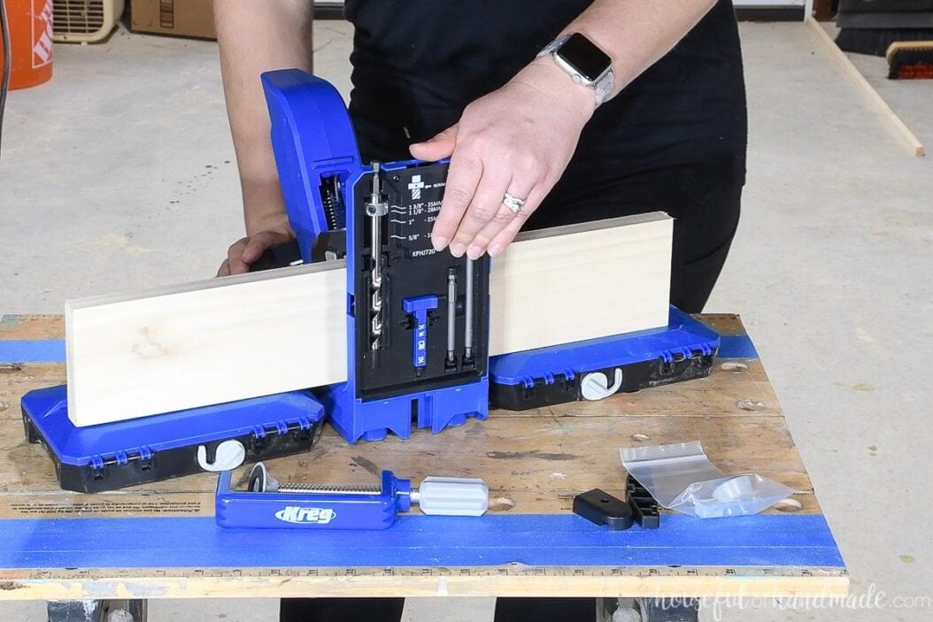 Showing a long board being supported by the optional docking station on the new Kreg jig.