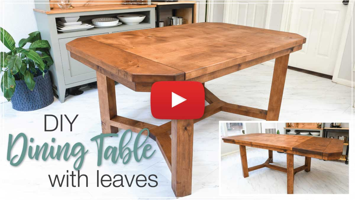 Dining table YouTube video thumbnail with play button on top.