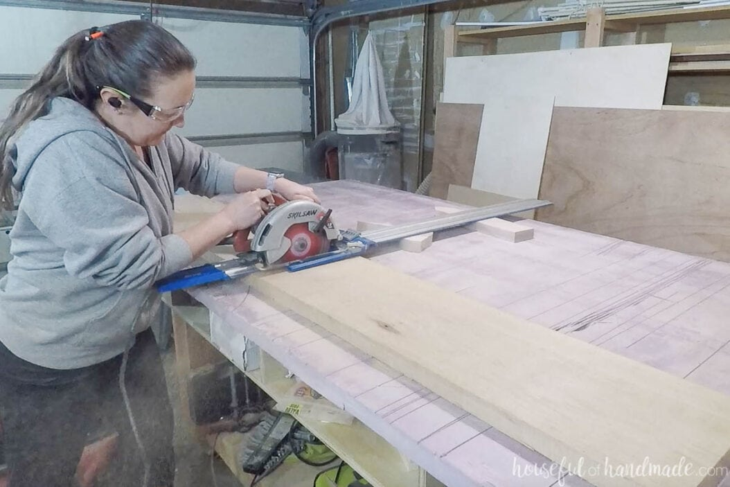 Cutting the top of the bench with a circular saw and guide track.