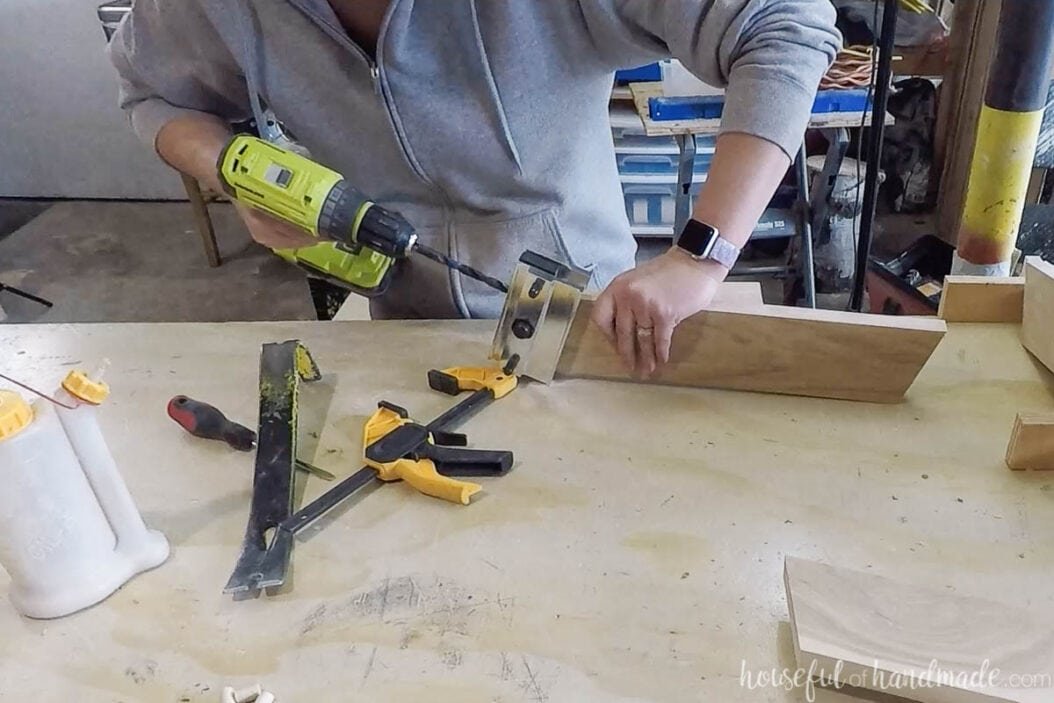 Drilling dowel pin holes in the top of the leg pieces with a self-centering doweling jig.