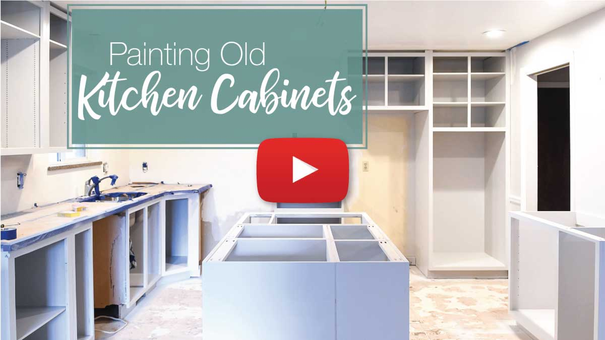 Kitchen cabinet video tutorial thumbnail with play button on top.