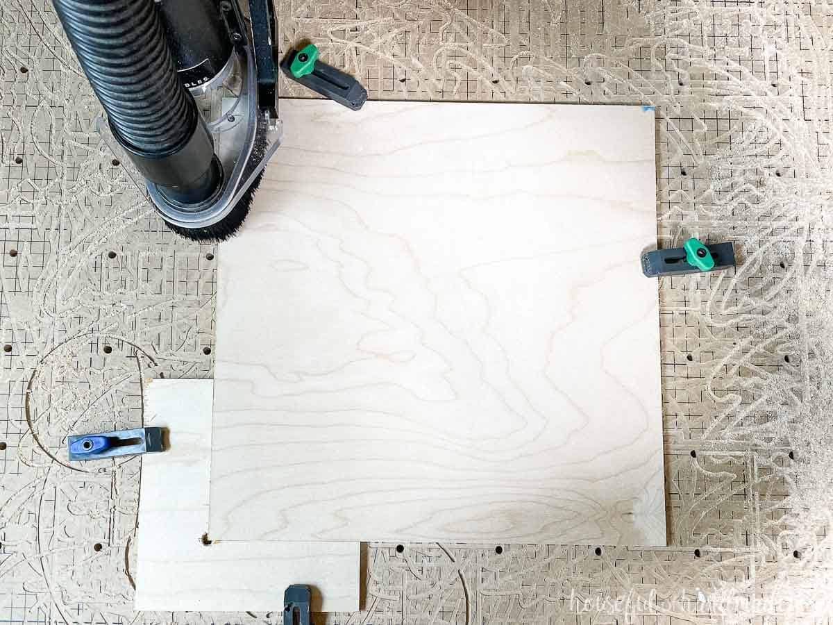One of the plywood tiles clamped onto the X-carve waste board.