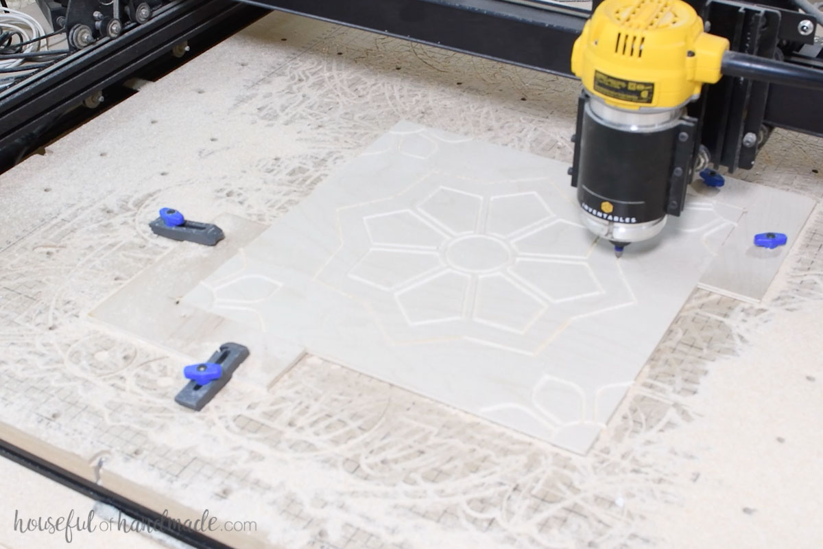 X-carve carving the design for one of the patterned tiles.
