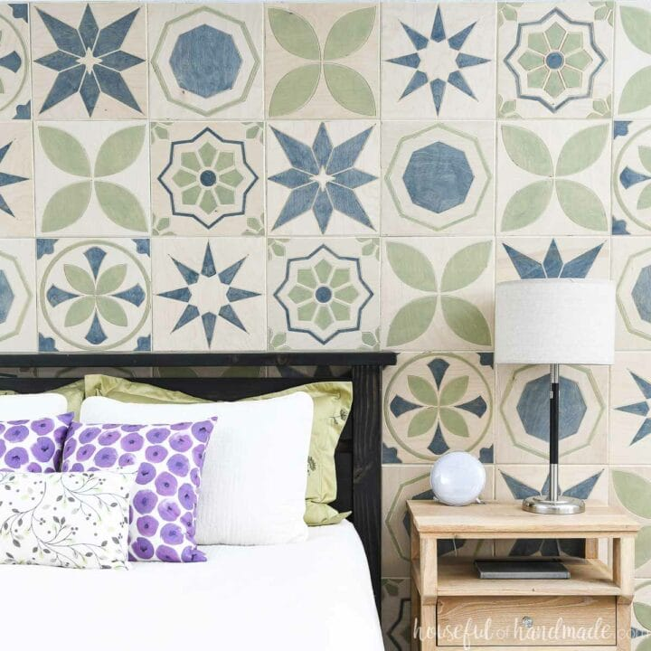 Bedroom accent wall made of carved wood tiles with patterned tile designs on it.