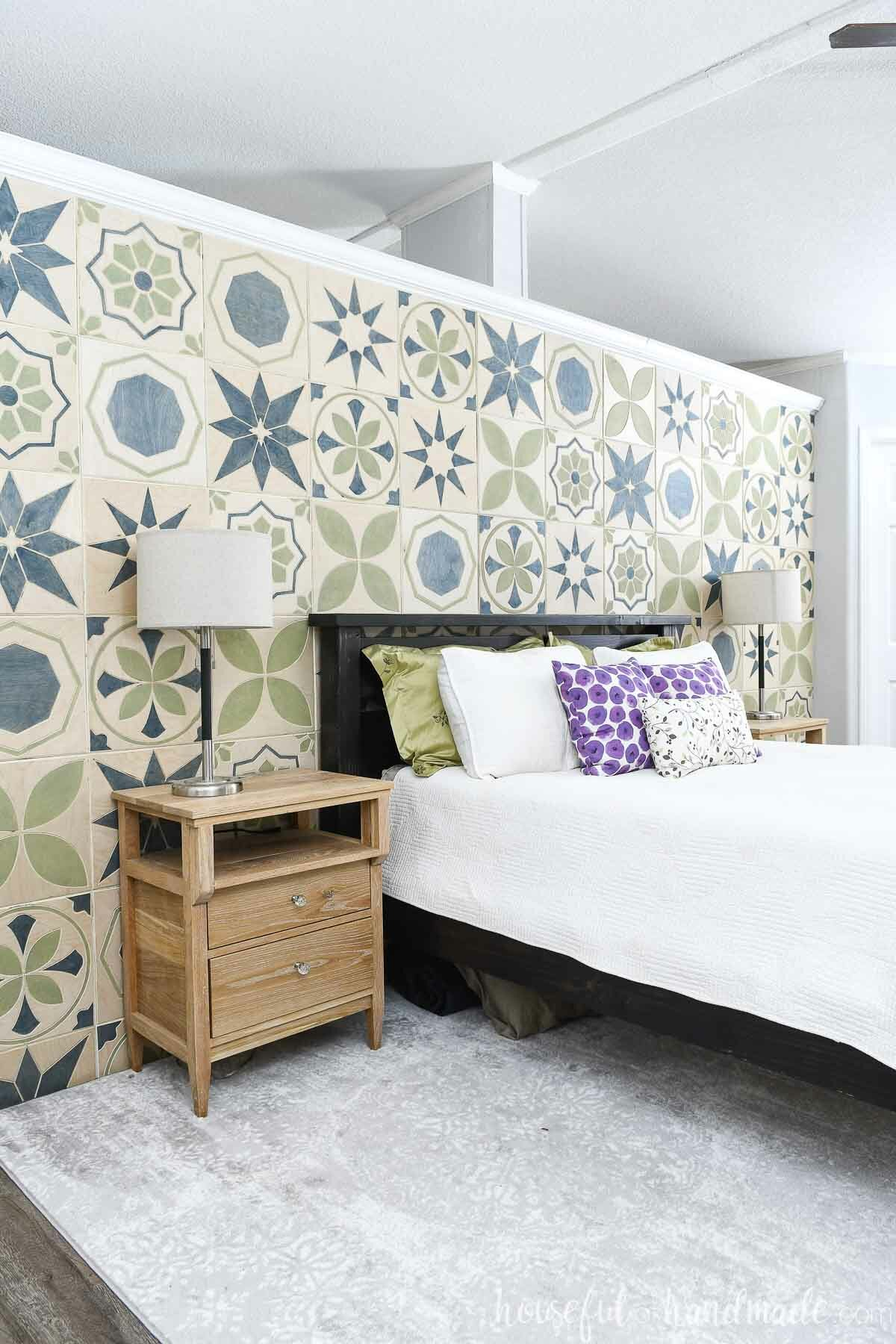 Master bedroom with a DIY accent wall made of patterned wood tiles on the wall behind the bed.