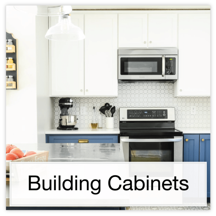 Two tone kitchen with white upper cabinets and blue lower with DIY cabinets and text button: Building Cabinets.