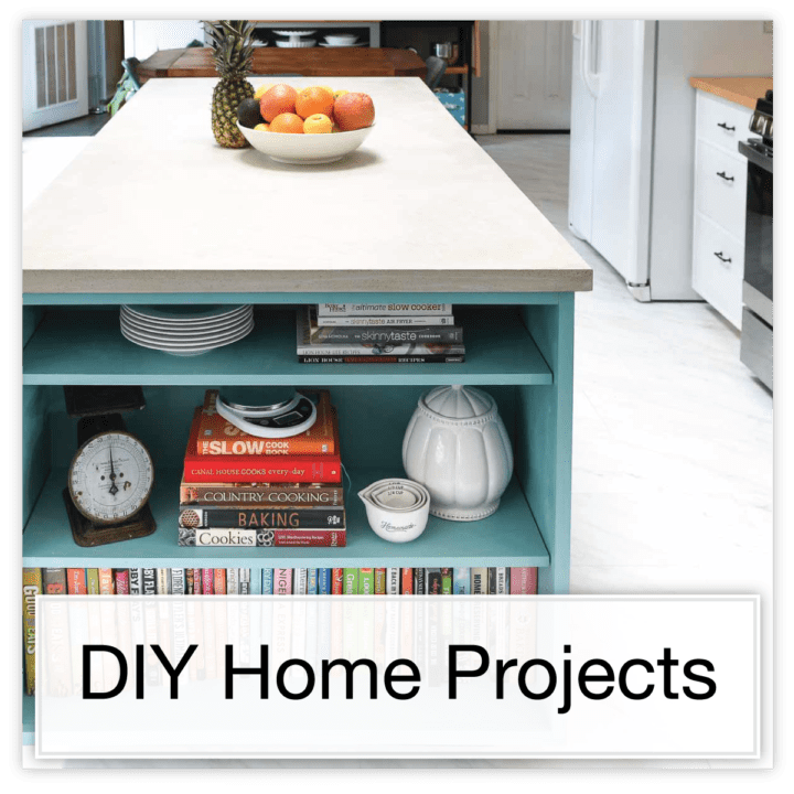 Colorful kitchen island with bookcase on the end and DIY concrete countertop with text button: DIY Home Projects.