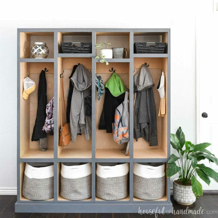Straight on view of the DIY mudroom storage lockers with light wood inside and gray-blue painted outside.