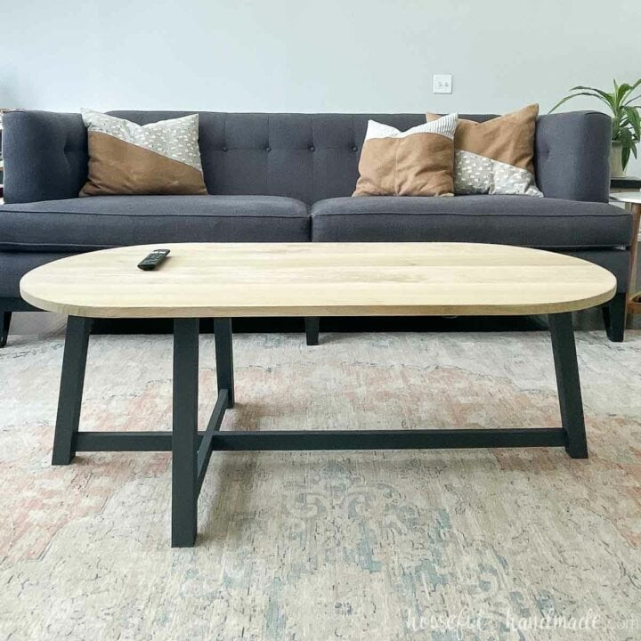 Rounded top and asymmetrical base coffee table in a living room.