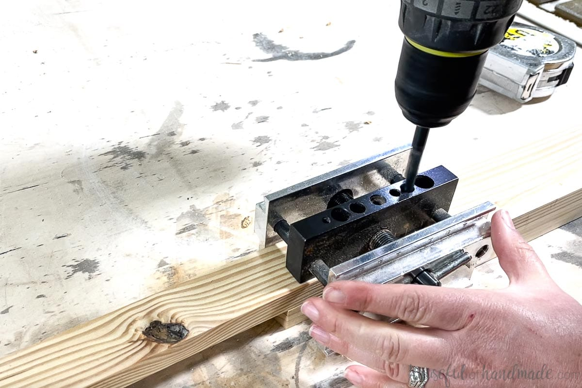 Using the self-centering doweling jig with a scrap piece added to offset the dowel holes.