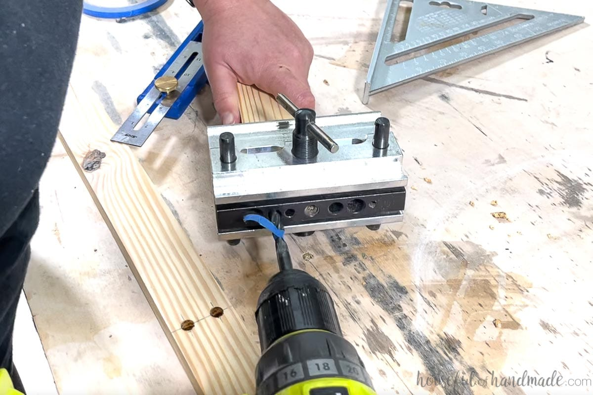 Using a doweling jig to add holes to the end of a 1x2 for dowel assembly of the coffee table base.
