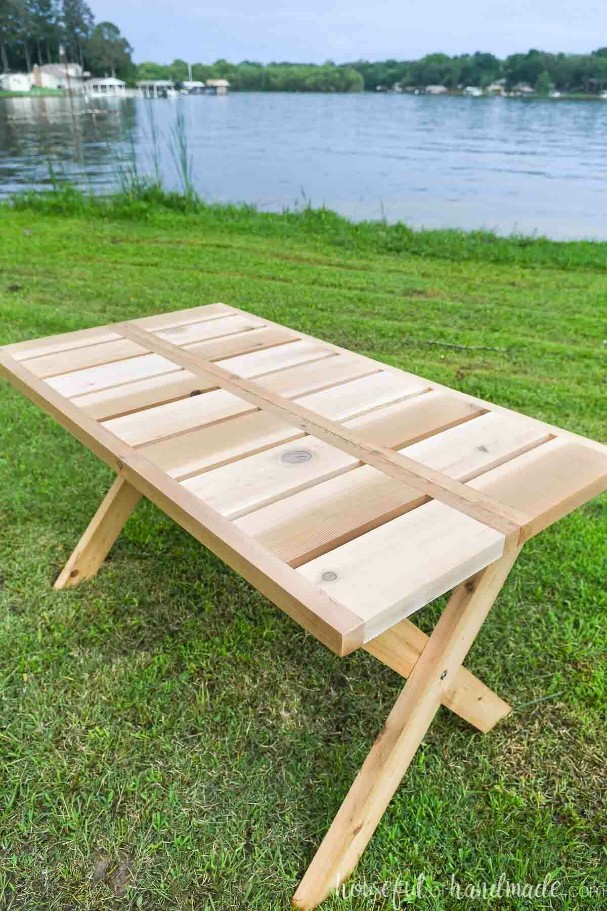 Looking at the top of the wooden folding picnic table made from cedar 2x6 and 2x2 boards.