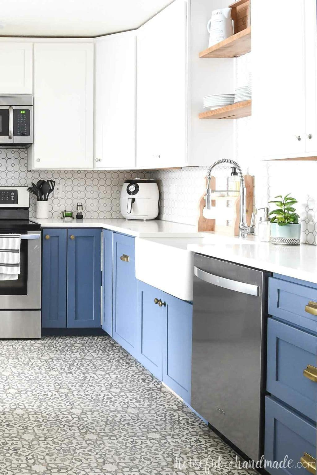 Kitchen with blue base cabinets and white upper cabinets with full overlay cabinet doors.