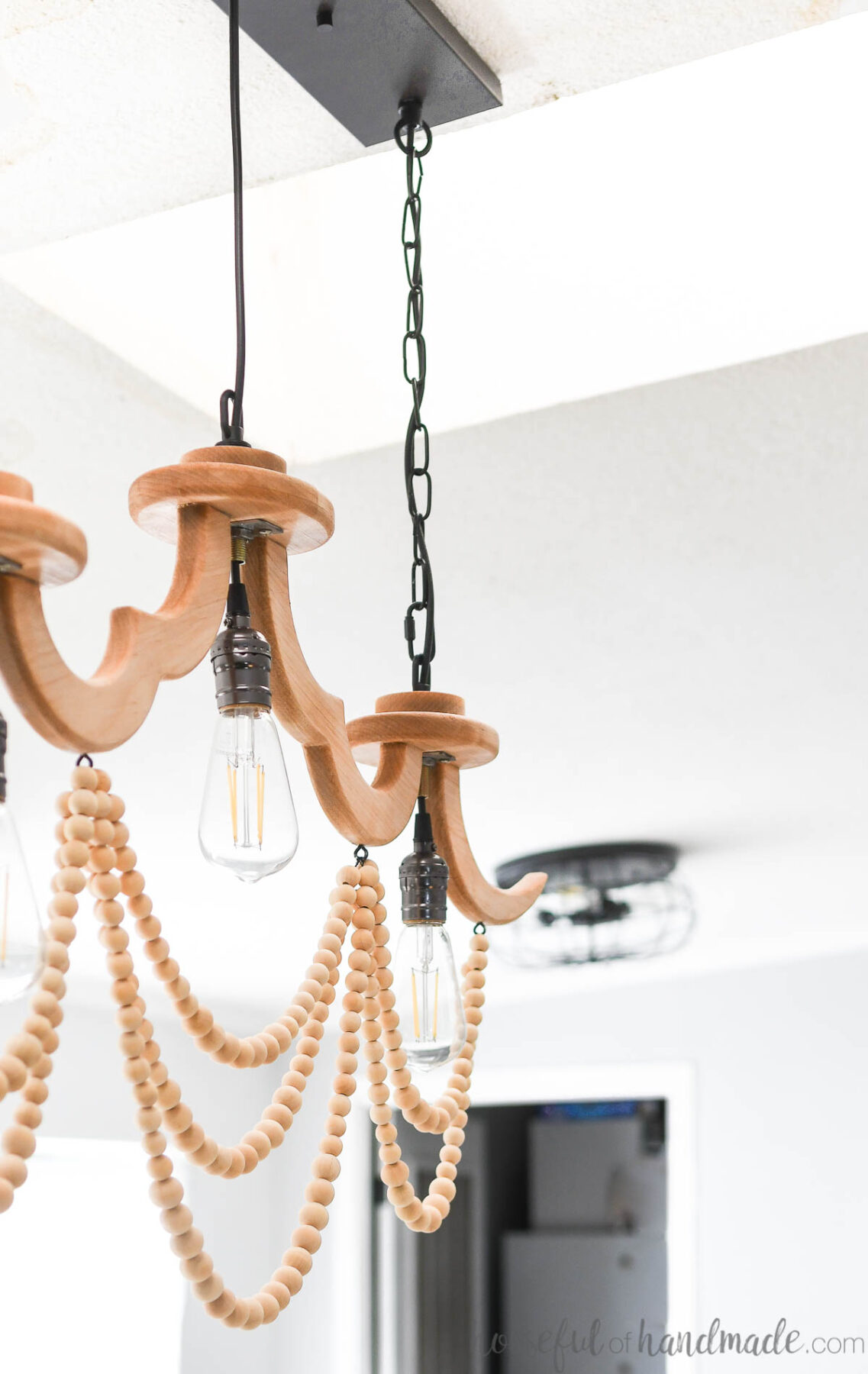 Close up of the DIY long chandelier hanging on the ceiling.