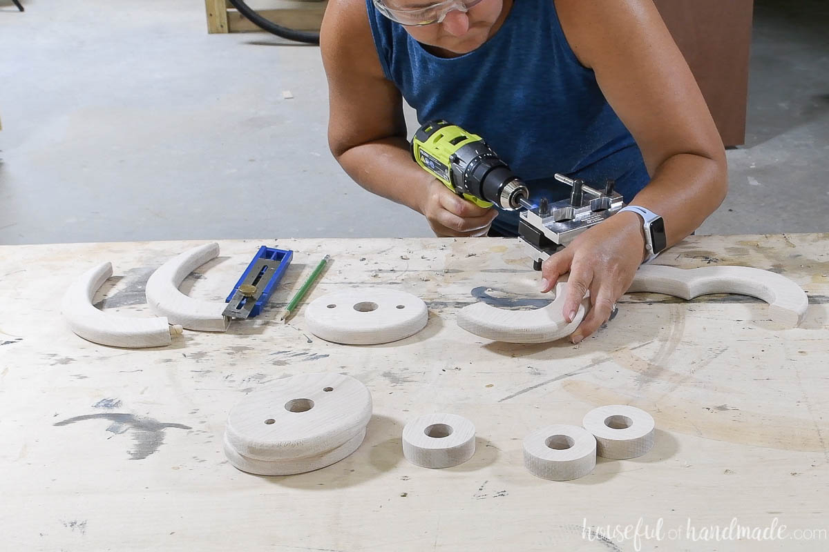 Drilling holes for dowels with a self-centering doweling jig on the decorative pieces for the wood chandelier.