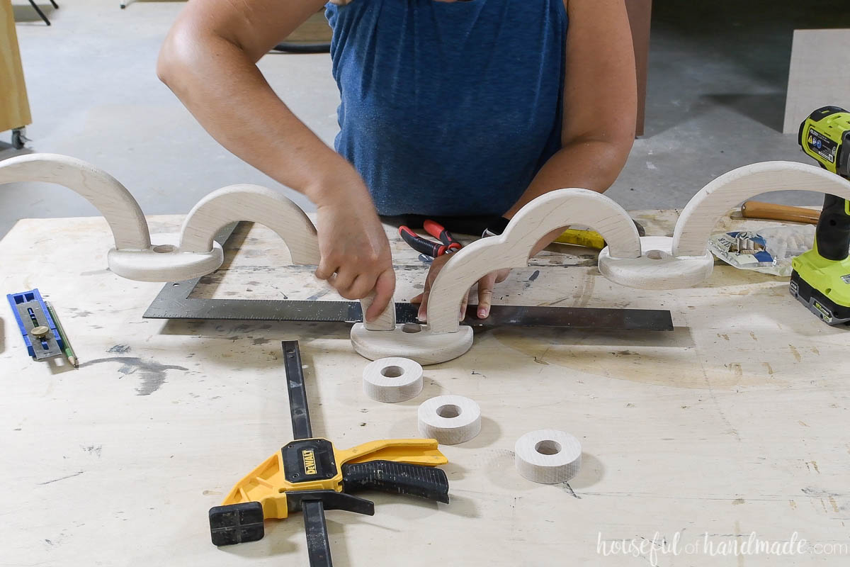 Using a straight edge to make sure the pieces are glued together straight.