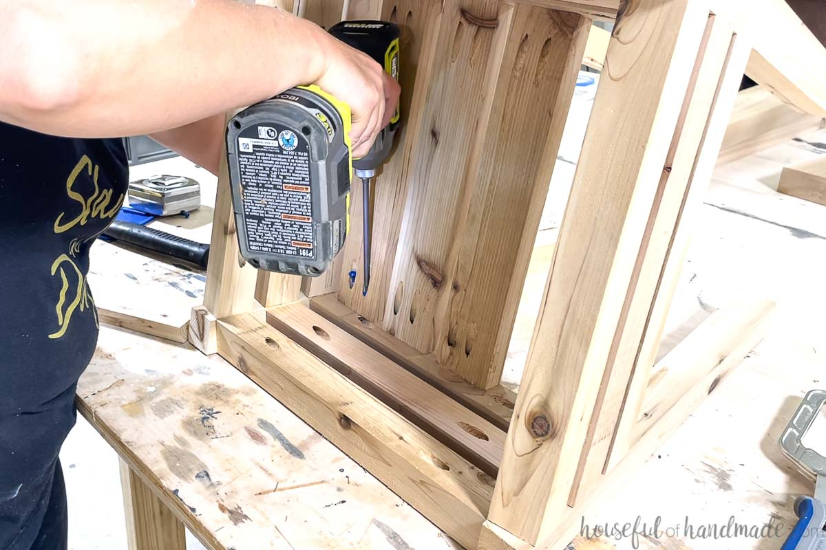 Attaching the shelf boards to the base with pocket holes.