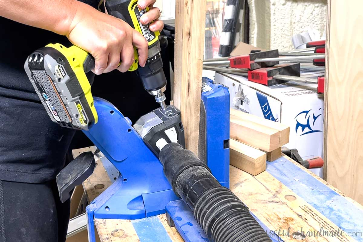 Using a Kreg jig to drill pocket holes in the boards.