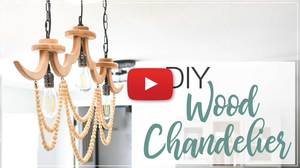 YouTube thumbnail for the DIY wood chandelier video with a red play button on the top.