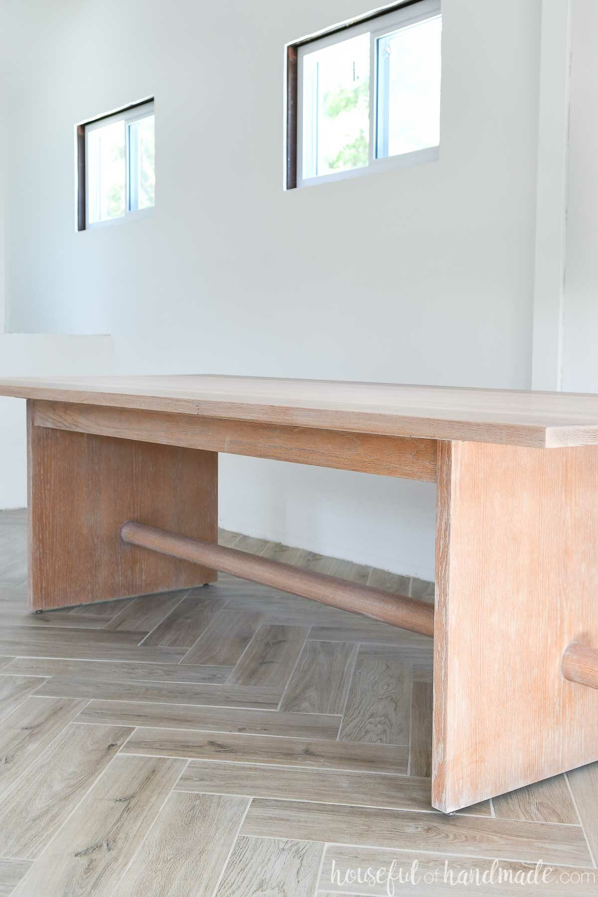 Looking down one side of the large dining table refinished with a modern matte sealer.