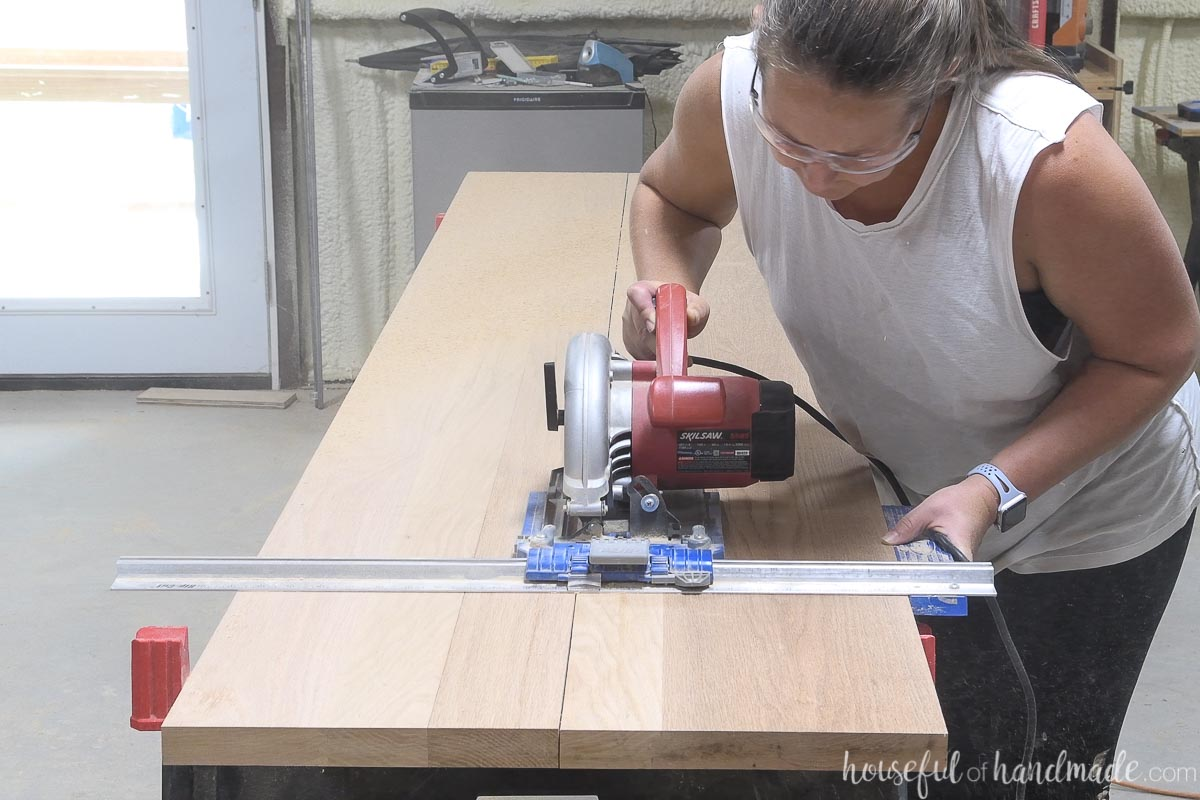 Cutting down the seam between two boards with a circular saw and Kreg RipCut.