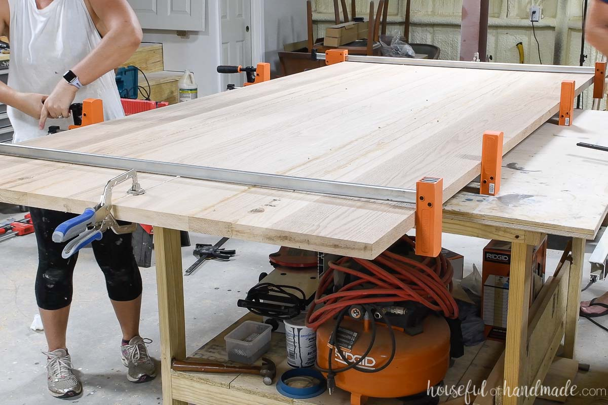 """Glueing all four 12"""" boards together for the oak table refinishing project."""