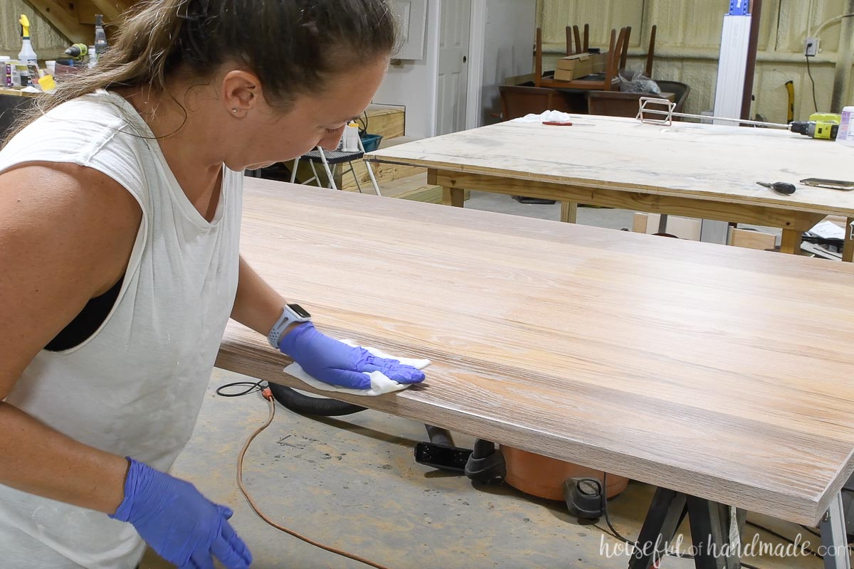 Buffing in the TrueTone finish over the Pickled white on the oak table top.
