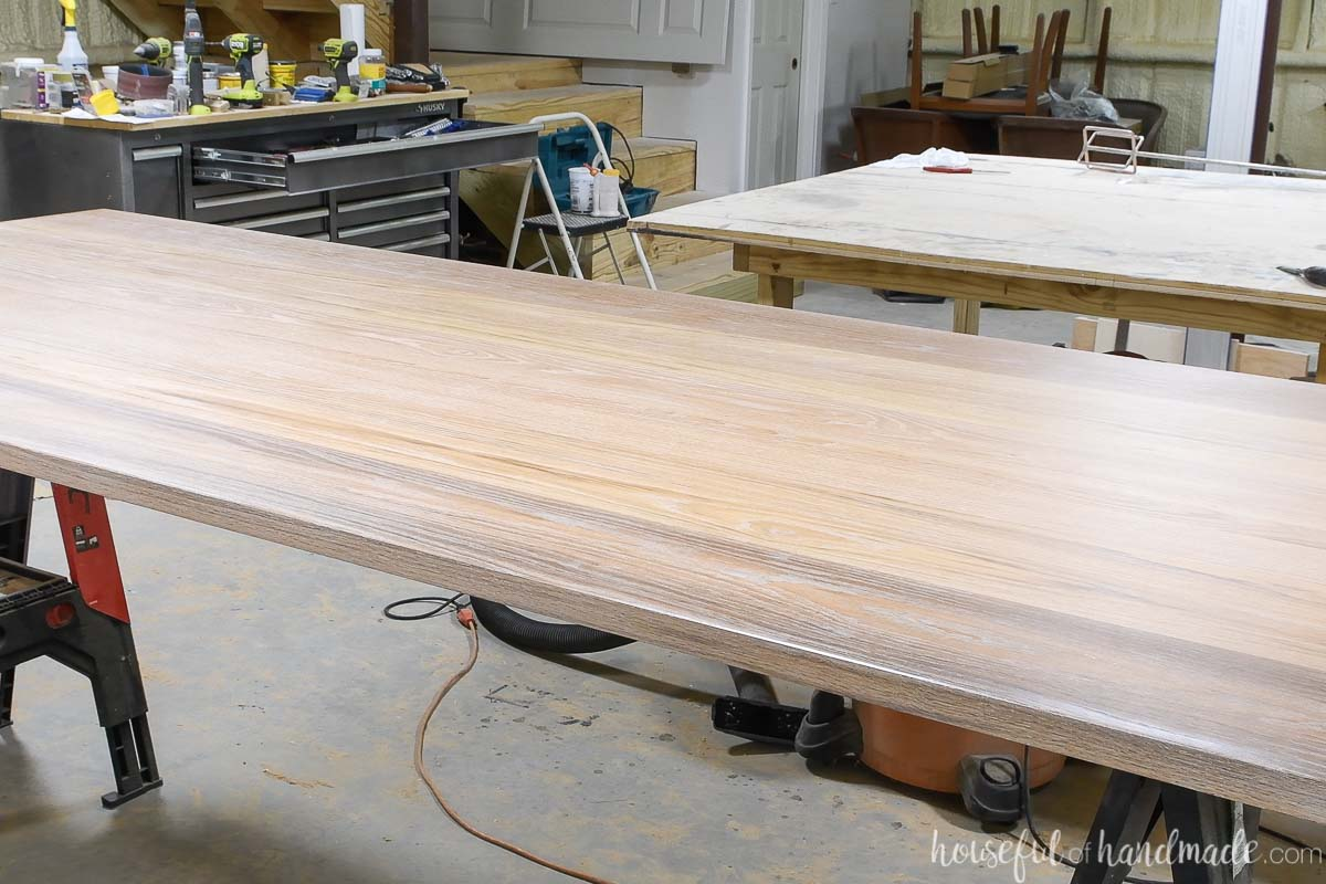 Solid oak table top refinished with Waterlox TrueTone Pickled white color and finish.